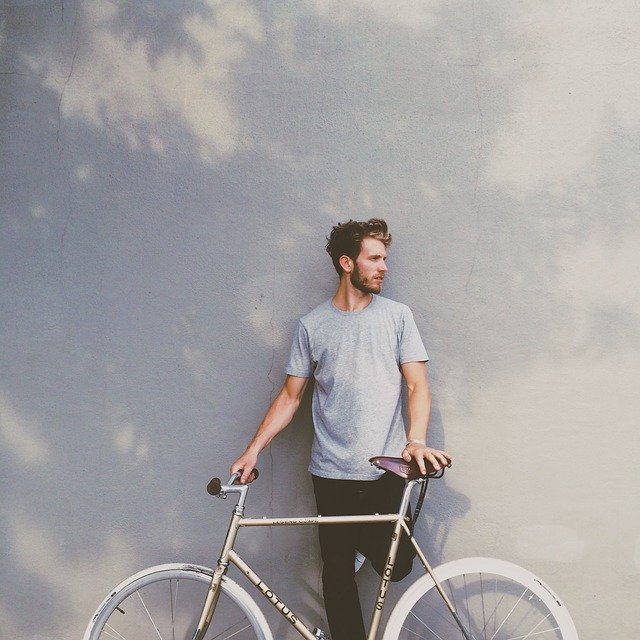A man holding a bicycle